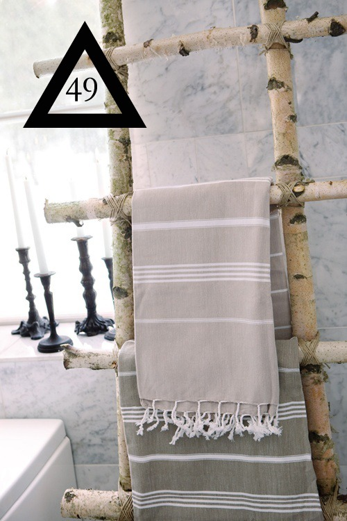a-rack-for-towels-or-magazines-using-tree-branches.jpg